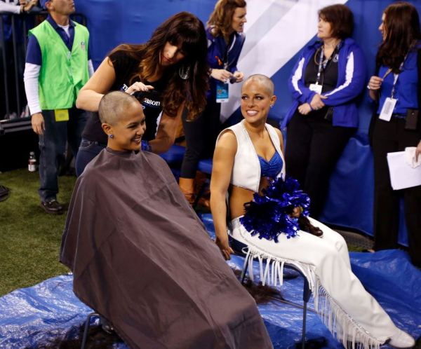 Colts cheerleaders shave their heads to raise money for cancer research.  (Photo by Brian Spurlock, US Presswire)